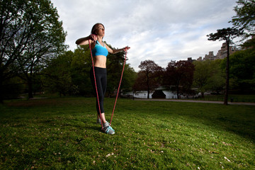 Young Woman skipping rope in Central Park, New York City
