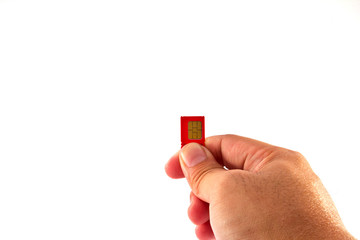 Fingers holding a mobile phone GSM SIM Card. Isolated on white b
