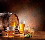 Fototapety Beer barrel with beer glasses on a wooden table.