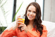 beautiful woman with glass of juice