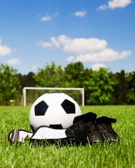 Child soccer or football gear on field