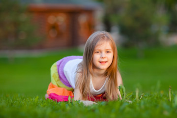 little girl having fun in summer park
