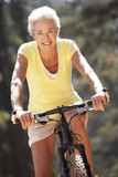 Senior woman on country bike ride