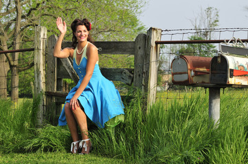 country pin up girl in a farm