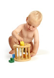 cute baby boy playing with a shape sorter toy isolated on a whit