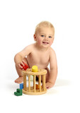 cute baby boy playing with a shape sorter isolated on a white ba