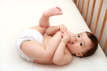 Baby sucking his toes