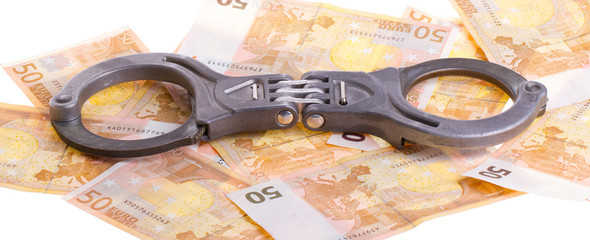 Handcuffs on 50 euro banknotes