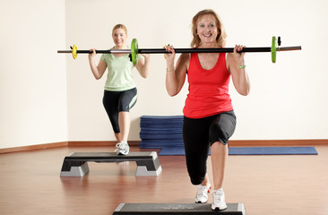 An Elderly woman and a young woman fitness workout