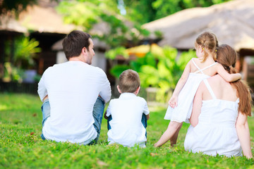 Family outdoors on summer day