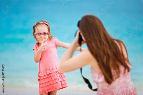 Mother photographing her daughter