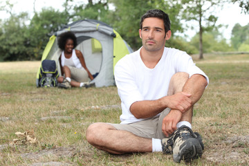 Relaxed couple camping