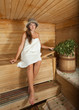 woman is sitting at sauna