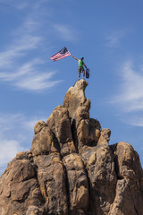 Waving a flag on the summit.