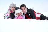 couple with child posing at ski resort