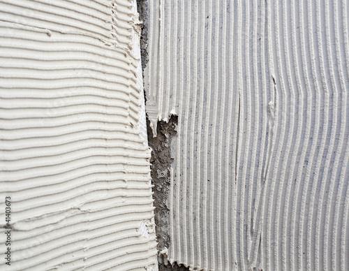 Poster construction notched trowel mortar shape on big tile