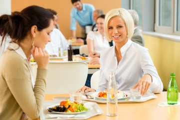 Cafeteria lunch young business woman eat salad