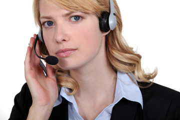 Serious blond call-center worker