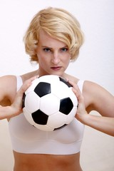 woman at home with a classic soccer ball