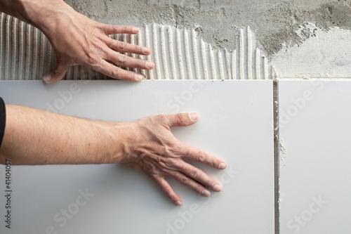 Poster construction mason man hands on tiles work