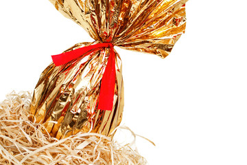 Golden easter egg detail in a nest