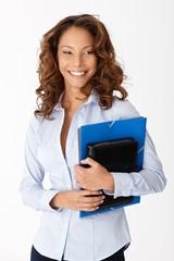 Beautiful woman smiling holding folders