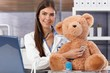 Doctor examining teddy bear