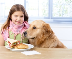 Portrait of little girl and dog smiling