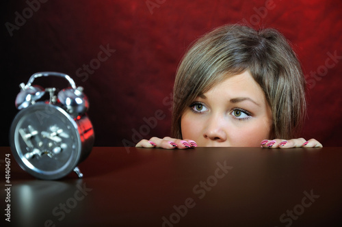Young woman with clock.
