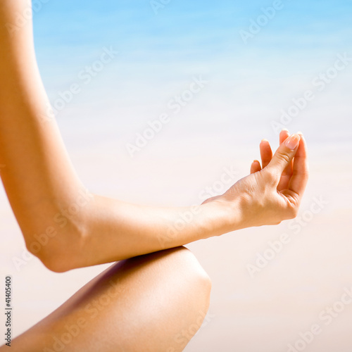 Woman doing yoga exercises or meditating