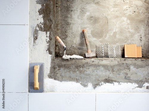 construction tools notched trowel and hammer Poster