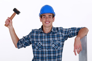 Young roofer with hammer