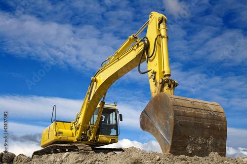 Leinwandbild Motiv Yellow excavator