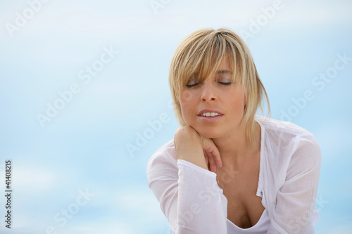 Woman unwinding alone at the seaside
