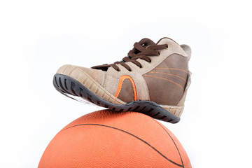 The new sports shoes with the ball on a white background.
