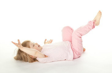 Happy girl having fun on the floor; white background