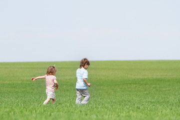 children playing on natural background