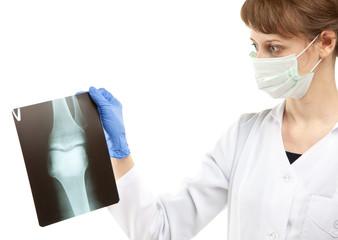 Female doctor examining X-ray