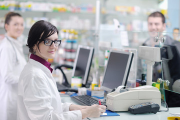 pharmacist suggesting medical drug to buyer in pharmacy