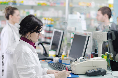 pharmacist suggesting medical drug in pharmacy drugstore