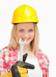 Woman holding a wrench