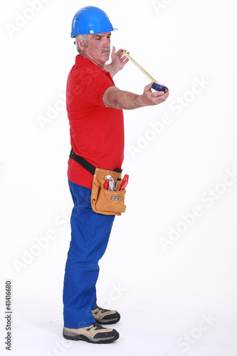 Senior plumber standing on white background