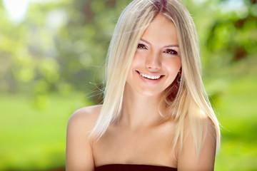 Portrait of happy blond woman