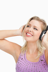 Cheerful woman wearing headphones
