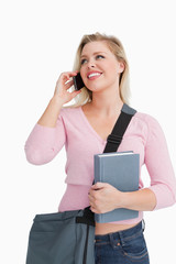 Smiling woman looking away while talking on the phone