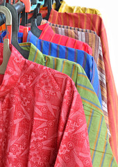 row of colorful gents kurtas