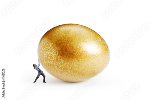 Man and golden egg isolated on white