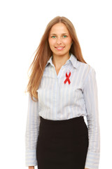 A young woman with an aids ribbon pinned to her shirt