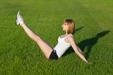 Young woman making fitness exercises, outdoor