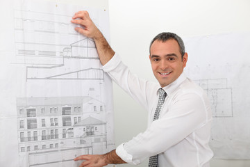 Smiling architect presenting project